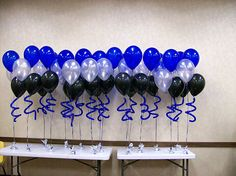 balloon boquets for table center pieces | Funky balloon columns with spiral arch and matching balloon bouquets ...