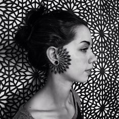 Dotwork mandala tattoo surrounding the right ear. Tattoo Artist: Corey Divine