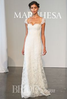 Brides.com: . Corded lace sheath wedding dress with a sweetheart neckline and cap sleeves, Marchesa