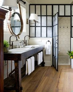 I love everything about this bathroom - shower tile, faucets, wood vanity....