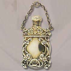 American Ladies Perfumer American early 20th century. Has a screw off cap and chain. This bottle measures 21/4 tall by 11/4 wide.