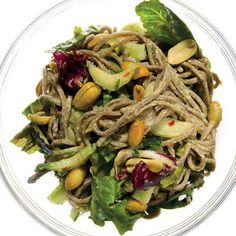 Sesame Soba Noodles with Cucumber, Bok Choy, and Mixed Greens Recipe Salads, Main Dishes with fresh orange juice, creamy peanut butter, rice vinegar, peeled fresh ginger, fresh lime juice, grate orang peel, soy sauce, garlic cloves, grate lime peel, crushed red pepper, canola oil, soba noodles, sesame oil, baby greens, baby bok choy, hothouse cucumber, green onions, chopped cilantro fresh, chopped fresh mint, salted roast peanuts