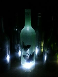 Wine bottles with butterfly stencil