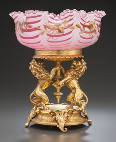 VICTORIAN ART GLASS AND GILT METAL CENTERPIECE. Circa 1880.