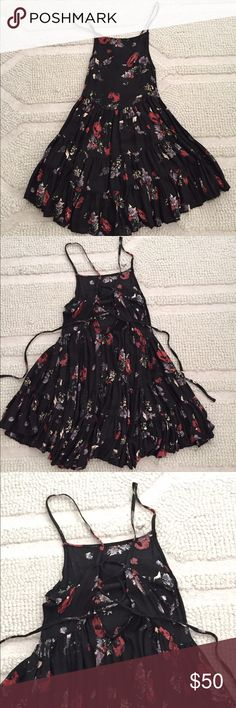 Free people black floral dress. Black floral dress with strappy back in XS. Worn once. Free People Dresses