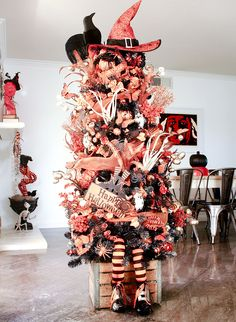 Halloween tree with orange and black decorations.  This year's theme is all about witches! #Halloweentree #Halloweendecorations #diyhalloween