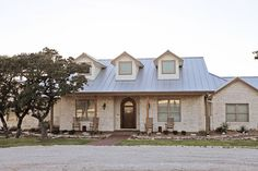 Traditional Home Metal Roof design with white stone, Cater Hill Country Ranch; galvalume standing seam roof - /meier-custom-built-homes-llc