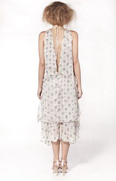 This elegant silk chiffon multi-layered dress has a slightly oversized fit and is very comfortable to wear. The main colour is light beige with small blue flowers. http://www.notjustalabel.com/shop/67827