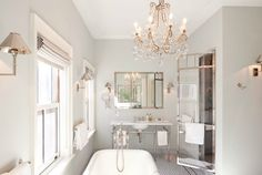 Suzie: Katie Lee's Home  Chic NY city bathroom with gray walls paint color, marble washstand, ...grey mist BMoore