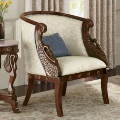"""Imagine yourself gliding across a river like the majestic swan—you'll get the same feeling whenever you sit upon this classically styled chair. The ample carved solid wood frame features exquisite swans on each side. Ivory jacquard upholstery has lyrical scrolling leaves. Rich pecan painted finish. Assembly required. 29"""" w x 34 1/2"""" h x 28"""" d. Pillow not included. Swan Chair#DI704987$329.00 Size/wt.: J"""