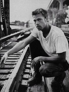 Brad Pitt, male actor, celeb, train tracks, rails, hands, fingers, powerful face, intense eyes, portrait, photo b/w.