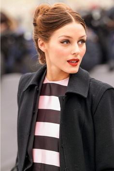 Olivia Palermo in a chic French twist, cat eyes, and red lipstick
