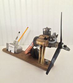 Pin by mac lexie on home office back to school pinterest aviation enthusiast desk organizer business card holder upcycled vintage rc airplane engine and parts colourmoves