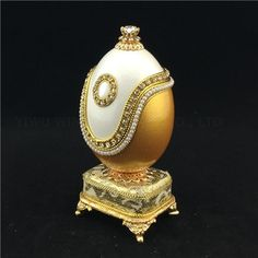 Real hand decorated goose egg trinket/Keepsake music box This exquisite and romantic Goose Egg Musical Box is delicately hand carved and adorned with faux pearls. It is genuine goose egg shell treated with reinforcement method. The egg opens with a hinge and it can hold treasures inside.
