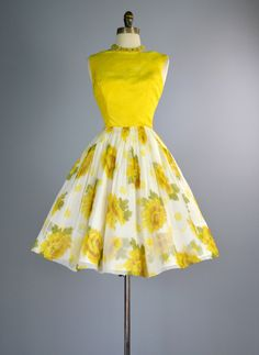 We are pleased to offer this beautiful dress from the late 1950s. ✂ FABRIC: This elegant party dress is fashioned from goldenrod yellow silk and