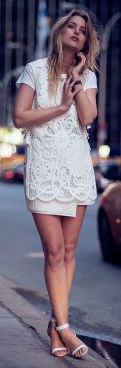 The best way to style an all white outfit for spring is with a stunning white crochet top, mini skirt and a pair of simple strapped heels. Via Rebecca Laurey  Top/Skirt: Tibi, Heels: The Mode Collective