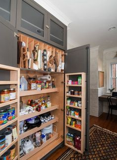 Like the vertical cookie sheet storage....from houzz.com