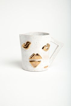 LUX / EROS Kiss Collection-  The Kiss Collection pays homage to the motif on vases and tumblers adorned with a variety of lips, some are sealed others open to a butterfly smack. Each Kiss carafe is handmade and original and comes with a kiss! - White glaze on speackled clay with gold lips detail