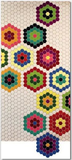 Hex tile Handmade tiles can be colour coordinated and customized re. shape, texture, pattern, etc. by ceramic design studios