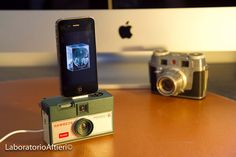 iPhone charger / dock from vintage camera- INSTAMATIC HAWKEYE. $89,00, via Etsy.