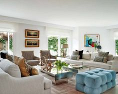 I like this layout with two couches, 2 chairs and ottomans