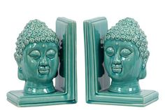"""A beautiful turquoise glazed finish on a set of two Buddha head bookends would make a dramatic focal point for your table or bookcase.  Includes a set of two. Measures: 8"""" H x 6.5"""" W x 4.5"""" D"""