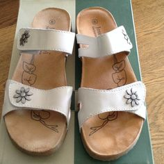 "Joseph Seibel cream color sandals Cream color leather with metal flower detail. Both straps are adjustable with Velcro. Super comfortable suede footbed. Cork sole with rubber-like on the bottom. ""The  European Comfort Shoe"". Worn once. Joseph Seibel Shoes Sandals"