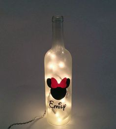 Personalized Minnie Mouse Wine Bottle Lamp / by ShopOfBottles Plastic Bottle Crafts, Diy Bottle, Wine Bottle Crafts, Mason Jar Crafts, Bottle Art, Wine Bottles, Miki Mouse, Fiesta Mickey Mouse, Painting Glass Jars