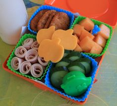 Here's a fun combo of finger foods for young kids. Love the pumpkins cut out of cheese!
