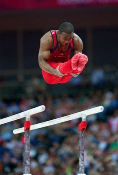 John Orozco of Team USA competes on the parallel bars during the London Olympics' men's gymnastics all-around final.