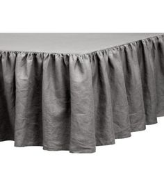 Gray. PREMIUM QUALITY. Three-sided bedskirt in washed linen with top section in cotton/polyester. Drop size 17 3/4 in. Tumble drying will help keep linen