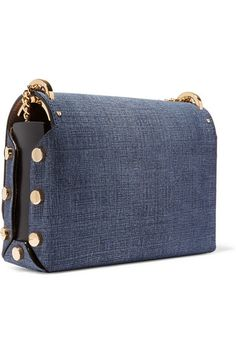Dark-blue denim, black leather (Calf) Push lock-fastening front flap Designer color: Light Indigo Comes with dust bag Weighs approximately 2lbs/ 0.9kg Made in Italy