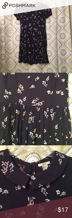 Floral Navy Peter Pan Collar Dress NWOT floral navy dress.  Short sleeves with an adorable Peter Pan color.  Zipper closure up the back of the dress.  Very swingy material. Forever 21 Dresses Mini