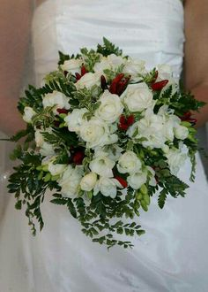 Bride's Gorgeous Bouquet Which Includes: White Roses, White Freesia, Red Chili Peppers, Green Foliage, Green Leather Leaf Fern, Green Maiden Hair Fern