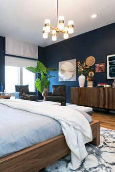 We layered color, texture and patterns with sophisticated navy blue walls and warm wood accents in this neutral yet eclectic master bedroom. We wanted to give the space balance and interest to combat the idea that neutral means boring! Navy Bedroom Walls, Blue And Gold Bedroom, Dark Blue Bedrooms, Blue Master Bedroom, Dark Blue Walls, Wood Bedroom, Bedroom Green, Bedroom Colors, Modern Bedroom