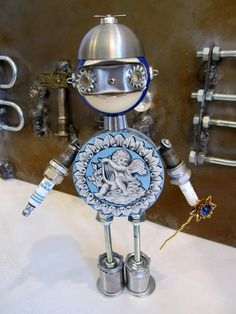 'Snow Bunny,' a Kewpie Bot - found object robot sculpture assemblage made by Bitti Bots (Cheri Kudja)