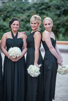 Glamorous Bridesmaids -- Long Black Gowns --  See More: http://www.StyleMePretty.com/california-weddings/2014/05/27/elegant-rancho-las-lomas-wedding/ Photography:  Jasmine-Star.com