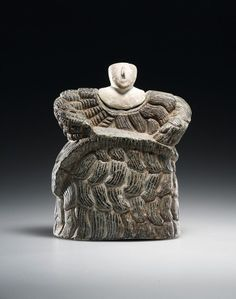 A GODDESS WEARING A KAUNAKES H. 11.6 cm. Chlorite, white calcite. Western Central Asia, Bactria-Margiana, Middle to Late Bronze Age, 2000-1650 B.C. The block-like female figure is shown standing, clad… - Galerie Cahn - 13/11/2015