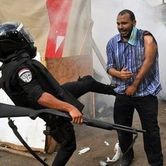 CItizens fighting for democracy while police and the military try to keep order in Egypt.