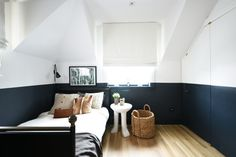 Half-painted walls give a stylish look to a monochromatic room from If you love the look of black walls but are afraid of the room becoming too cavelike, this is a great compromise. Half Painted Walls, Half Walls, Bedroom Wall, Kids Bedroom, White Bedroom, Bedroom Chair, Bedroom Ideas, Two Tone Walls, Block Wall