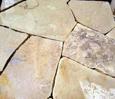 Laying flagstone patios in sand is easy, although the stone itself can be heavy. This DIY project is like building a puzzle; I show you how here.