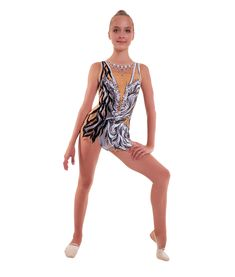 Exquisite sand color leotard made from lycra with the painting by acrylic paints will help to create a look of a nimble amazon girl, easily manipulated with any apparatus. Suitable not only for beginners, but for adult gymnasts as well. Amazon Girl, Rhythmic Gymnastics Leotards, Gymnasts, Competition, One Piece, Black And White, Create, Skirts, Swimwear