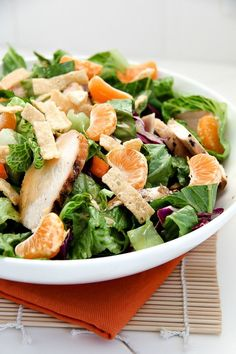 Asian Chicken Salad with Mandarin oranges | This salad makes for the perfect dinner table accompaniment, with colorful flecks of bright orange mandarins and purple cabbage.