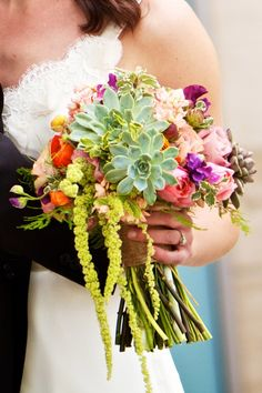 Succulent wedding bouquet with trailing accents.