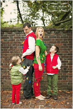 Christmas Family Photo's from the most amazing Matt Malicote Photography. Tangled in Christmas lights done right.