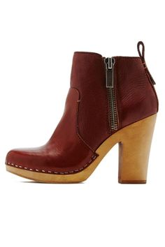 """Zip into this wood bottom ankle-bootie and transcend to 70's style bliss. Dress this one up or down! Functioning zippers on both sides of the bootie.    Heel height: 4""""   Arlynn Bootie by Dolce Vita. Shoes - Booties - Heeled Wisconsin"""