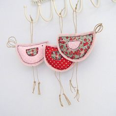 This extremely cute lil birdy is made from cottons appliqued using a freehand machine embroidery technique, backed onto a quality wool fabric.  Fabulous for hanging on door handles and hooks, these lil birdies just loves to hang around!  Available in Red Polka, Pink Polka and Floral.  Birdy has a slightly padded body.  The body measures 10cm x 6cm with those lovely legs taking it to approx 16cm  5 pounds
