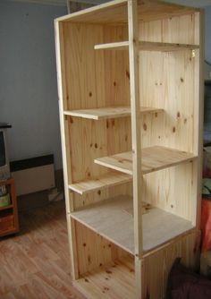 Simple but functional wooden chinchilla cage setup.
