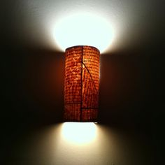 I made it! DIY sconce cover. pages from Thai book, dyed with coffee, cut up and reassembled, mod podged, hot glued on wire and hung to cover my ugly 70's sconces.