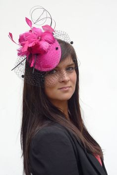 Lovely hand made minihat Pippa Middleton style but with character of its own. $129.00, via Etsy.